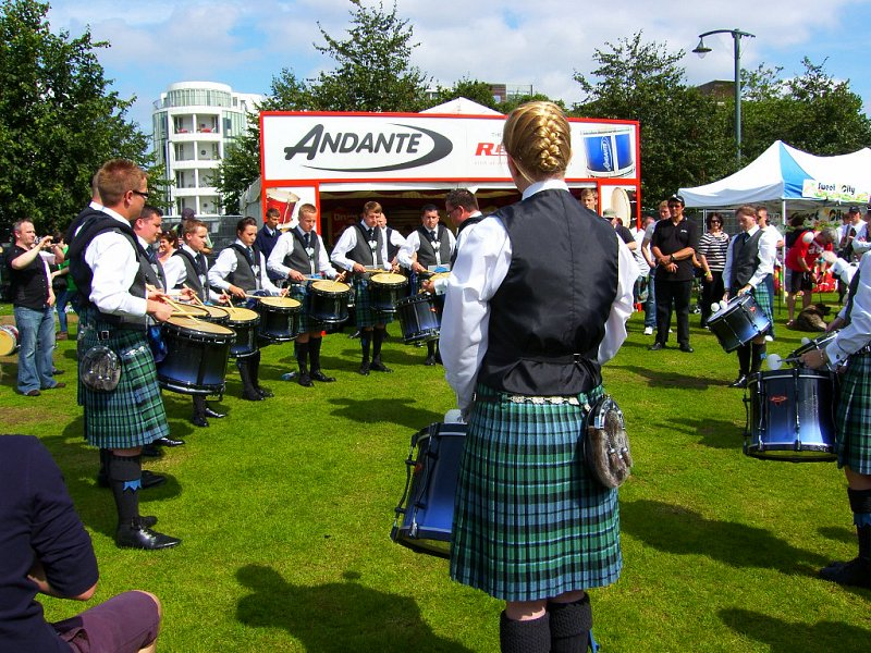 Inverary & District Drum Corps with Lead Drummer Steven McWhirter, outside the 'Andante Exhibit' at the World Pipe Band Championships, Glasgow in August 2012.
