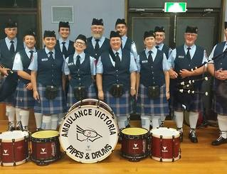 Ambulance Victoria Pipes & Drums proudly showing their Andante Drums.