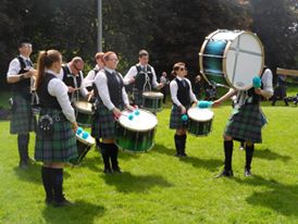 Colmcille Pipe Band from Derry, Northern Ireland for these impressive pictures of the guys performing.