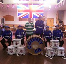 County Flute Band from Scotland for these great pictures with their sponsor for the special Olympics.