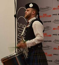 Great photo is of Craig Lawrie performing in the final at the World Solo Drumming Championships.