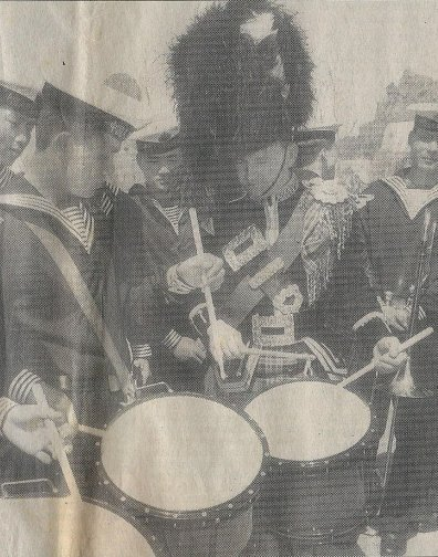 John Scullion of Scottish Power Pipe Scotland, taking a breather to discuss drumming with Zhang Lian (Left) of the China Navy Soldier's Band at the '95 Beijing International Band Festival.