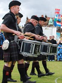 Peter Vardy Glenrothes & Distrist PB from Scotland for this great photo of the guys performing in the circle at the Worlds - 2010