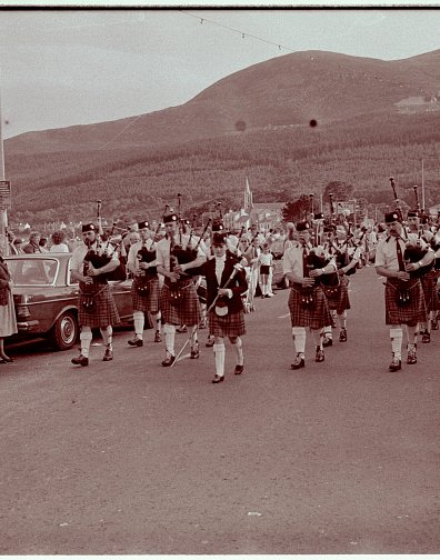 Moneygore Pipe Band parading along Newcastle Pormenade after competing in the All Ireland in the early 80's, with Sam's daugther Lorraine 'Drum Major', leading the band.