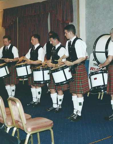 Lothian & Border Drum Corps with Leading Drummer Arthur Cook on left, performing at the launch back in 2000.