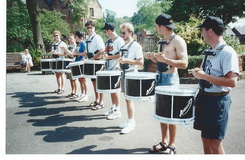 78th Fraser Highlander Drum Corps performing with their new DTS6 Andante Snare Drums, with Leading Drummer Harvey Dawson fifth in from right, during the mid 90's.