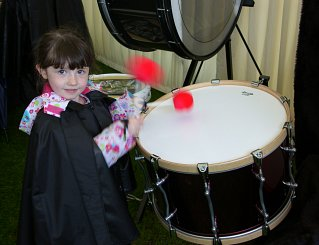 Isla making sure the Tenor Drums and sticks are working